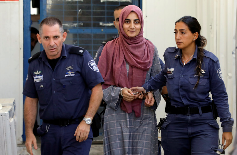 Turkish citizen, Ebru Ozkan, who was arrested at an Israeli airport last month, is being brought to an Israeli military court, near Migdal, Israel July 8, 2018 (photo credit: REUTERS/NIR ELIAS)