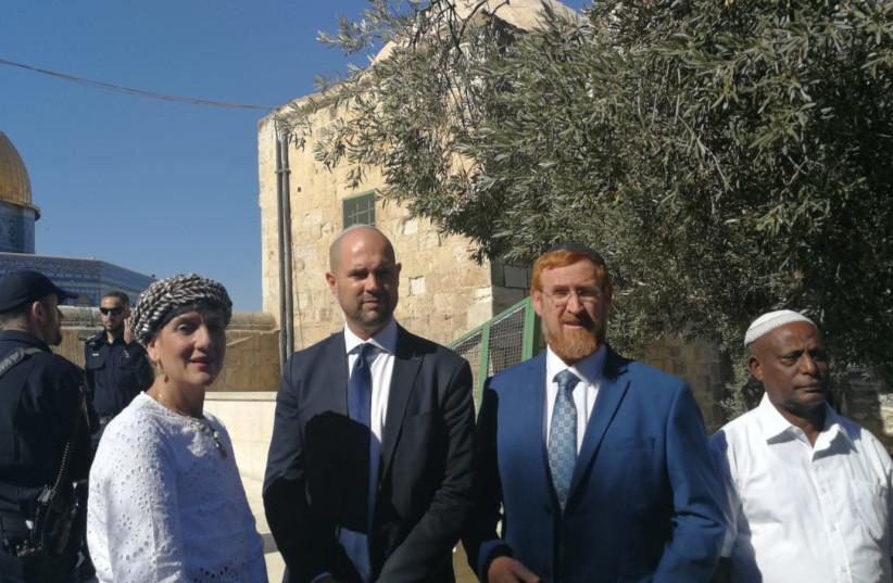 ehuda Glick (R),  Amir Ohana (C) and Shuli Moalem-Rafaeli (L) vist the Temple Mount, July 9, 2018 (photo credit: EZRA GABBAY)