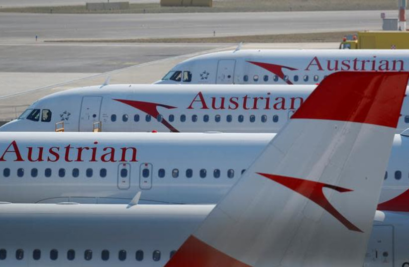 Planes of Lufthansa unit Austrian Airlines are parked at Vienna International Airport in Schwechat, Austria March 22, 2018 (photo credit: REUTERS/LEONHARD FOEGER)