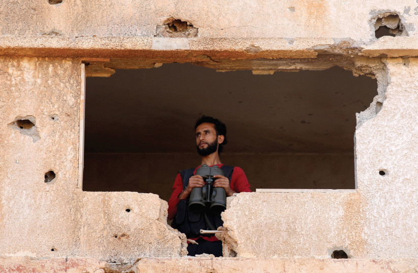 A FIGHTER from the Free Syrian Army is seen in the Yadouda area in Dera'a. (photo credit: REUTERS)