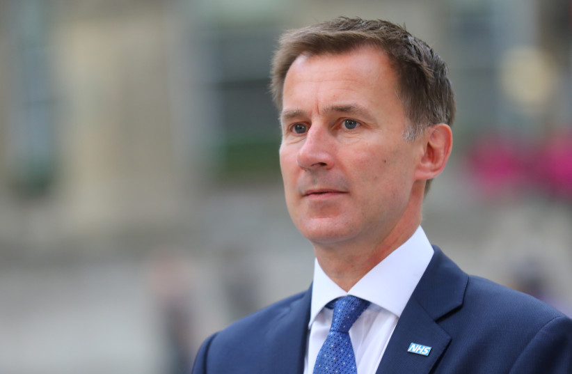 Britain's Secretary of State for Health and Social Care Jeremy Hunt arrives at the BBC in central London, Britain, July 9, 2018 (photo credit: REUTERS/SIMON DAWSON)