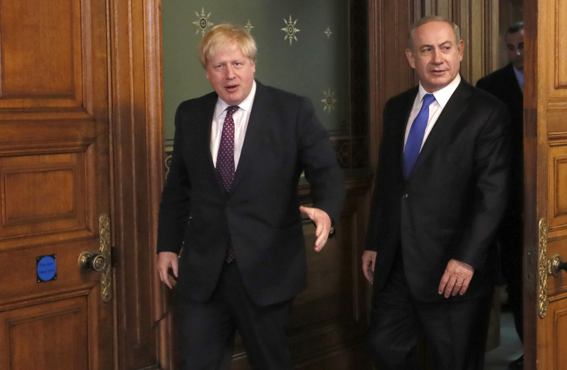 Britain's Foreign Secretary Boris Johnson (L) greets Israel's Prime Minister Benjamin Netanyahu at the Foreign Office in London, February 6, 2017 (photo credit: REUTERS/KIRSTY WIGGLESWORTH/POOL)