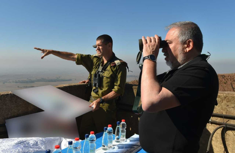 Defense Minister Avigdor Liberman looks at Syria from the Golan Heights (photo credit: ARIEL HERMONI / DEFENSE MINISTRY)