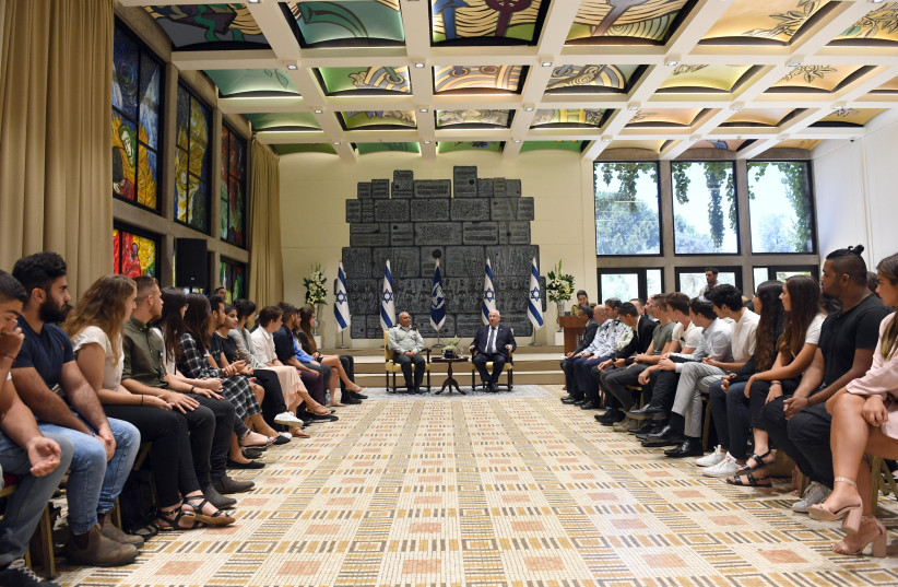 President Reuven Rivlin and Chief of Staff Lt.Gen. Gadi Eisenkot meeting with 70 influential teenagers at the President's residence on Tuesday, July 10, 2018.  (photo credit: HAIM ZACH/GPO)