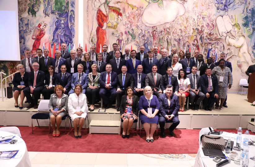 Members of parliaments from around the world pose with Speaker of the Knesset Yuli Edelstein during the conference.  (photo credit: YITZHAK HARARI)