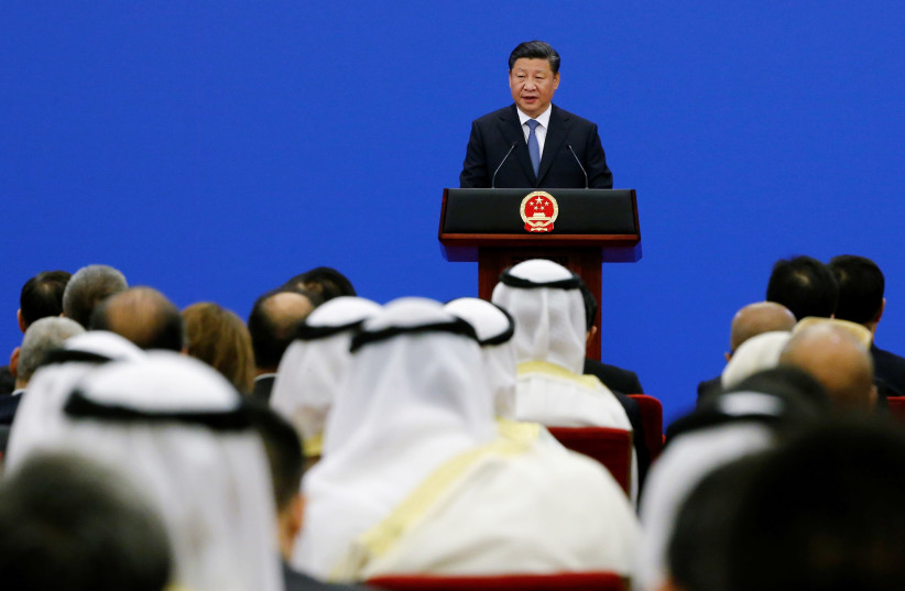 Chinese President Xi Jinping speaks to representatives of Arab League member states at a China Arab forum at the Great Hall of the People in Beijing, China, July 10, 2018.  (photo credit: THOMAS PETER/REUTERS)
