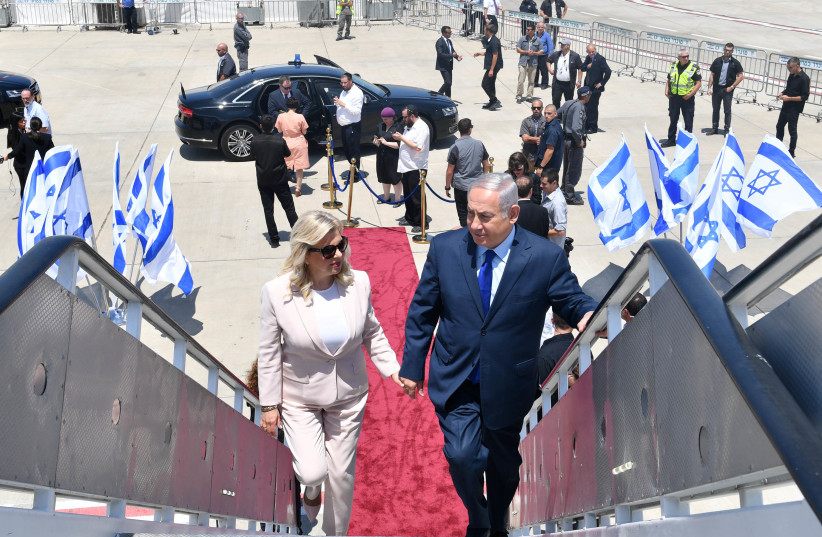 Prime Minister Benjamin Netanyahu and his wife Sarah before leaving for a diplomatic visit to Moscow, Russia (July 7, 2018) (photo credit: KOBI GIDON / GPO)
