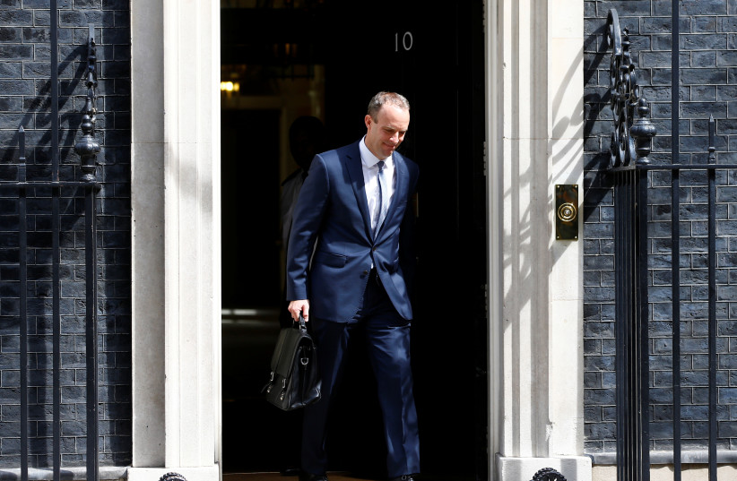 Britain's newly appointed Secretary of State for Exiting the European Union Dominic Raab leaves 10 Downing Street in Westminster, London, Britain, July 9, 2018. (photo credit: HENRY NICHOLLS/REUTERS)