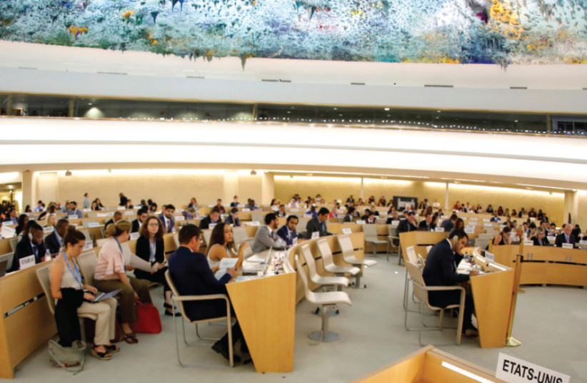 SEATS NORMALLY occupied by the United States delegation are empty one day after the US announced its withdrawal from the UN's Human Rights Council, at the United Nations in Geneva on June 20, 2018 (photo credit: REUTERS)