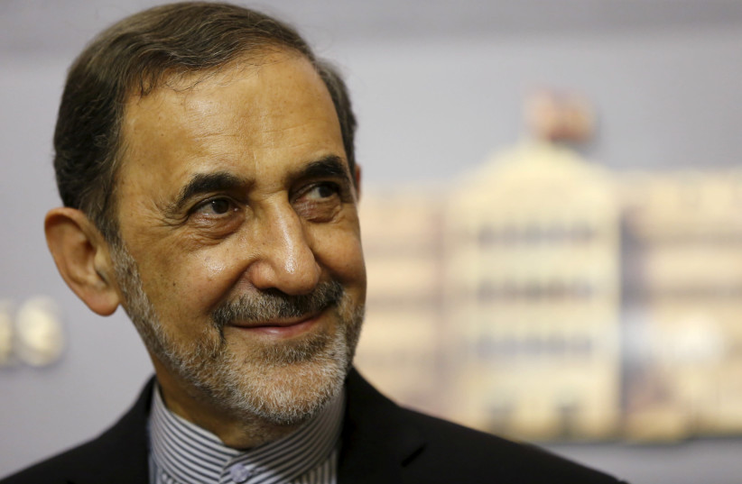 Ali Akbar Velayati, Iran's Supreme Leader Ayatollah Ali Khamenei's top adviser on international affairs, smiles as he listens to questions from the media during a news conference after meeting with Lebanon's Prime Minister Tammam Salam at the government palace in Beirut May 18, 2015.  (photo credit: MOHAMED AZAKIR / REUTERS)