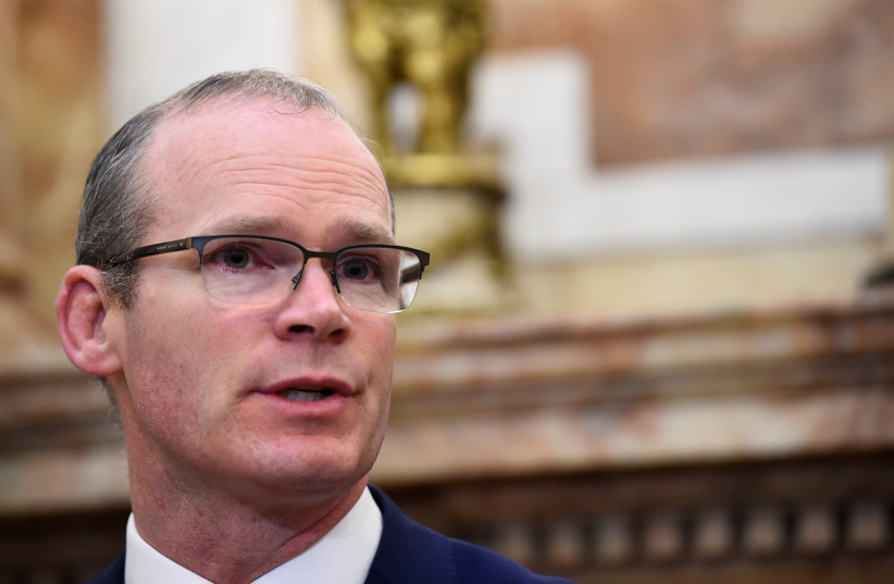 Ireland's Foreign Minister Simon Coveney speaks during a news conference in Dublin, Ireland, April 12, 2018. (photo credit: CLODAGH KILCOYNE/REUTERS)