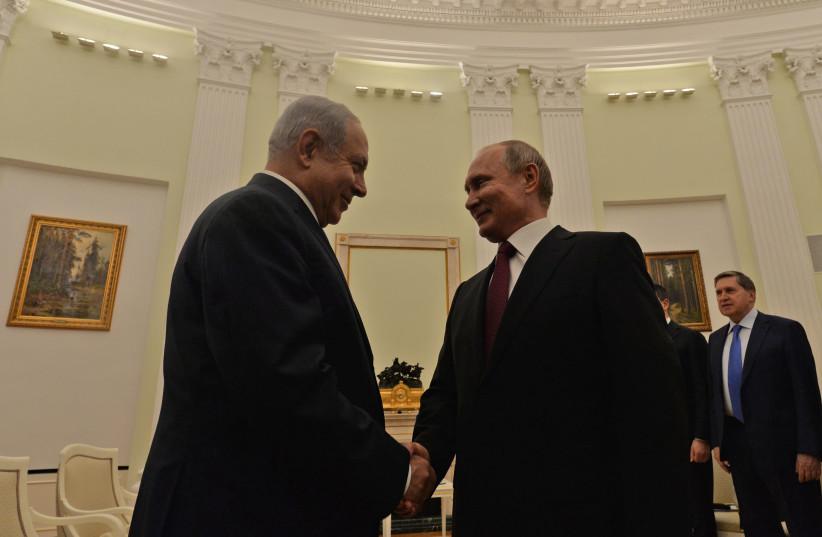 Prime Minister Benjamin Netanyahu shakes hands with Russian President Vladimir Putin  (photo credit: KOBI GIDEON/GPO)