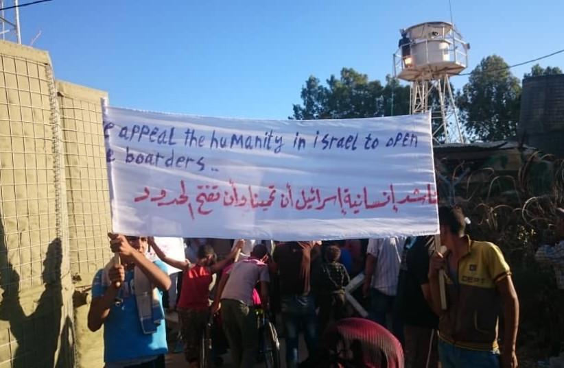 Near the Israeli-Syrian border, Syrian's call for Israel's help, July 12, 2018. (photo credit: EHUD AMITON/TPS)