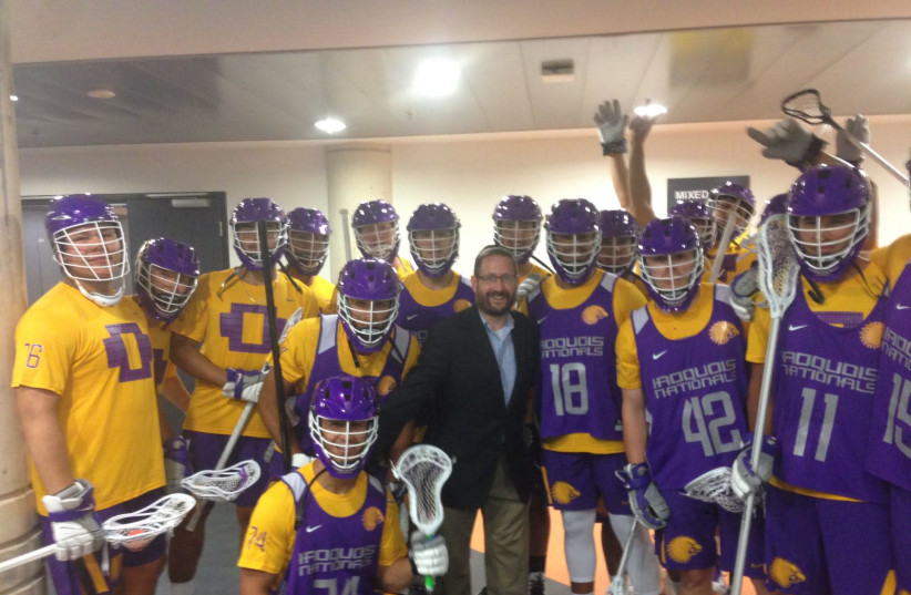 Former MK Dov Lipman poses with the Iroquois Nationals Lacrosse Team at the World Lacrosse Championship (photo credit: Courtesy)
