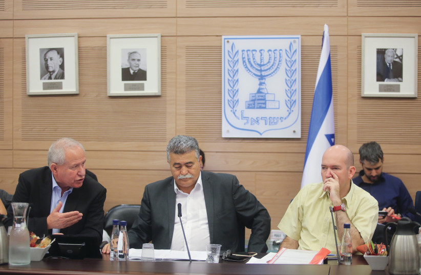 FOREIGN AFFAIRS  and Defense Committee's  Home-Front Readiness Subcommittee chairman  Amir Peretz (center) hosts a Knesset meeting on Thursday  about the country's readiness  for earthquakes.   (photo credit: MARC ISRAEL SELLEM)