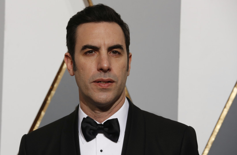 Presenter Sacha Baron Cohen arrives at the 88th Academy Awards in Hollywood (photo credit: ADREES LATIF/REUTERS)