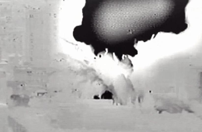 A screenshot from an IDF video of the IAF strikes in Gaza July 13 2018  (photo credit: IDF SCREENSHOT)