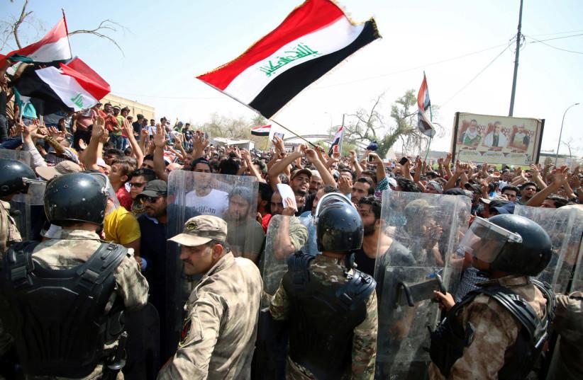 Protesters gather near the main provincial government building in Basra, Iraq July 15, 2018. (photo credit: ESSAM AL-SUDANI/ REUTERS)