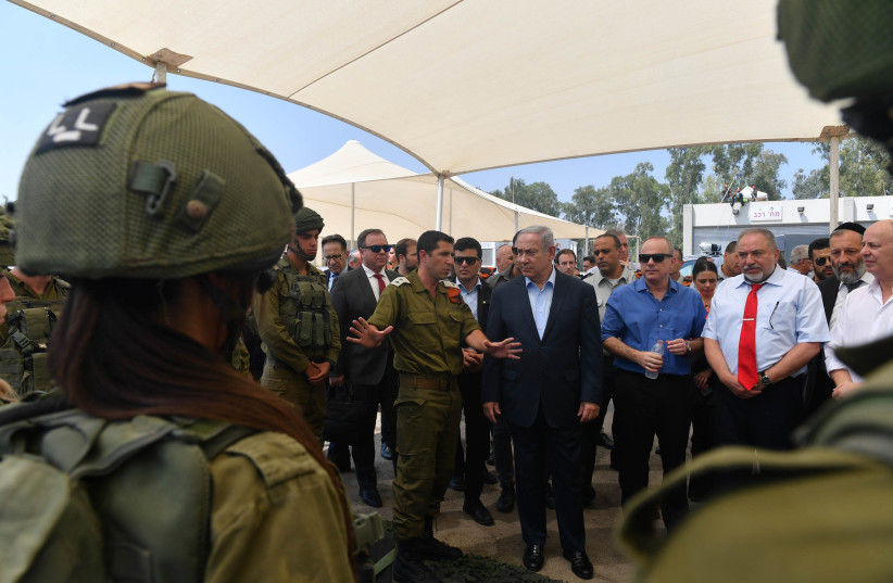 Prime Minister Benjamin Netanyahu and the security cabinet visit Homefront Command, July 16, 2018 (photo credit: KOBI GIDEON/GPO)