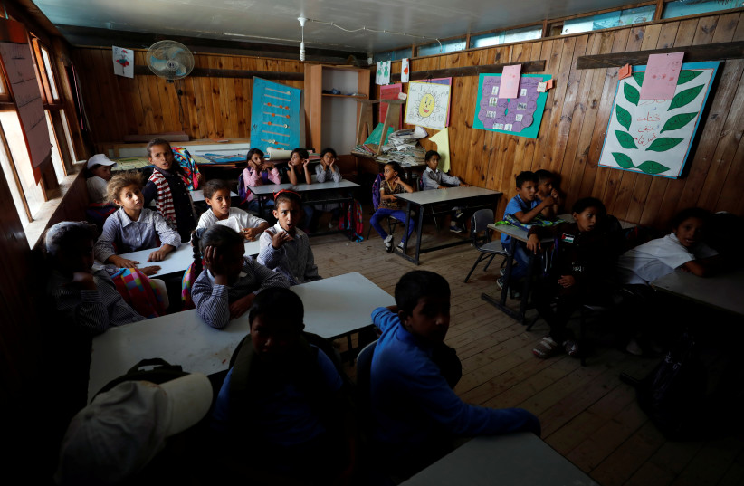 Palestinian children attend class at school that began in 2018 in Khan al-Ahmar that will be demolished in the West Bank (photo credit: REUTERS/MOHAMAD TOROKMAN)