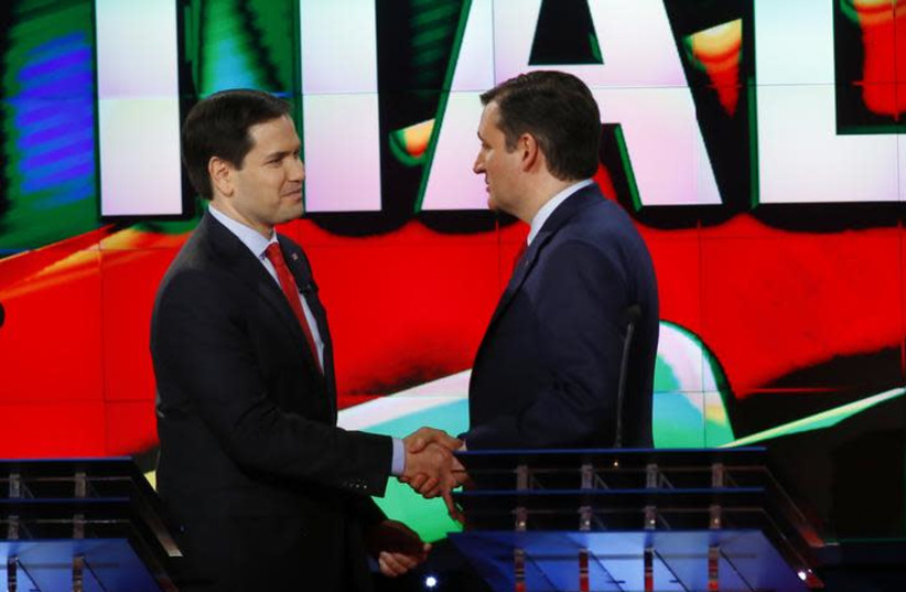 Marco Rubio (L) and Ted Cruz (R) shake hands (photo credit: REUTERS/MIKE STONE)
