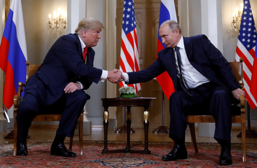 U.S. President Donald Trump and Russia's President Vladimir Putin shake hands as they meet in Helsinki, Finland July 16, 2018 (photo credit: REUTERS/KEVIN LAMARQUE)