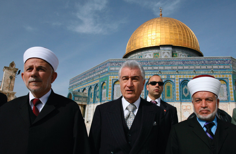 MUFTI OF JERUSALEM Mohammed Hussein (right) walks in front of the Dome of the Rock in 2007 (photo credit: AMMAR AWAD / REUTERS)