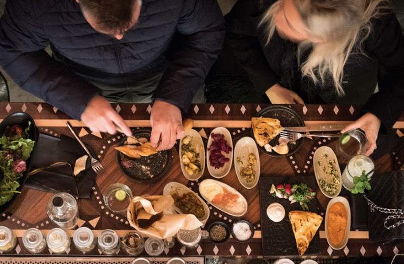 A table at Leyla bar-restaurant in Tel Aviv (photo credit: Courtesy)