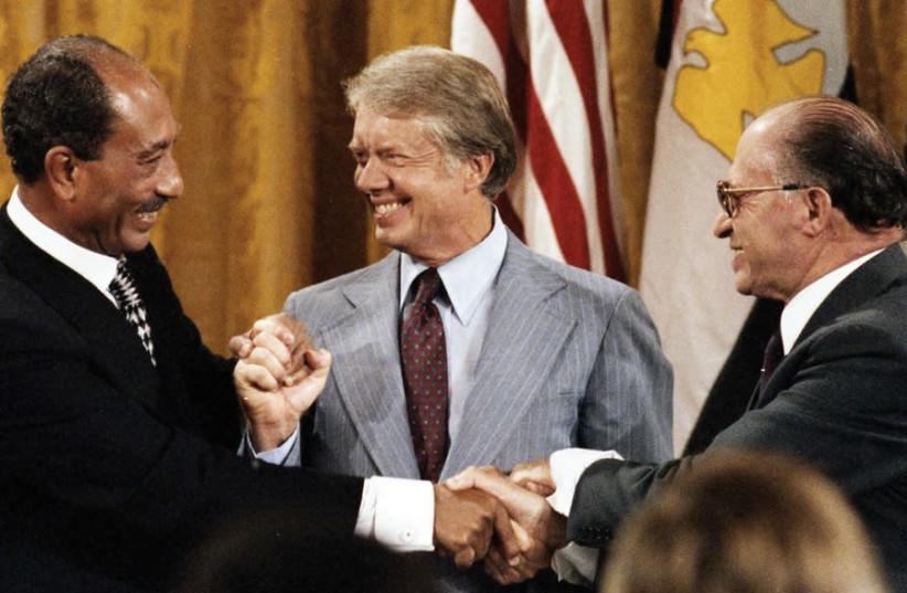 EGYPTIAN LEADER Anwar Sadat, US president Jimmy Carter and prime minister Menachem Begin meet at Camp David in September 1978 (photo credit: CIA)