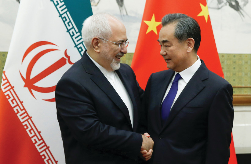 Chinese Foreign Minister Wang Yi meets Iranian Foreign Minister Mohammad Javad Zarif in Beijing in May (photo credit: THOMAS PETER/REUTERS)