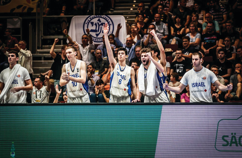 ISRAELI PLAYERS celebrate on the bench in the closing minutes of the blue-and-white's 80-66 victory over Croatia last night in the final of the 2018 FIBA Under-20 European Championship in Chemnitz, Germany, a result that gave Israel it's first-ever title at the event. (photo credit: FIBA EUROPE/ COURTESY)