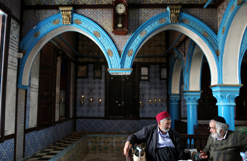 Two Tunisian Jewish men are seen at Ghriba, the oldest Jewish synagogue in Africa, Tunisia, 2018 (photo credit: AHMED JADALLAH / REUTERS)