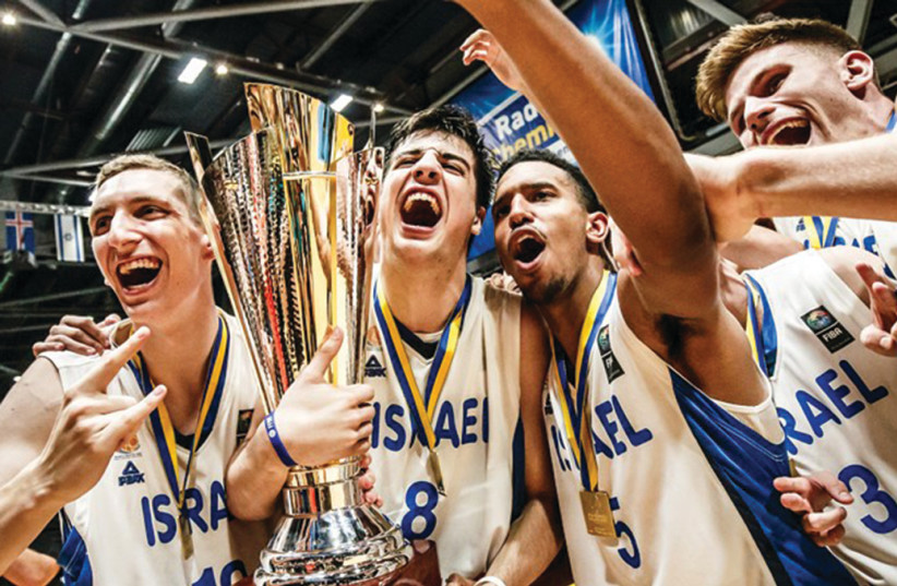 ISRAELI PLAYERS celebrate withtrophyfollowing victory over Croatia in final2018 FIBA Under-20 European Championship in Chemnitz, Germany, 2018 (photo credit: FIBA EUROPE/ COURTESY)