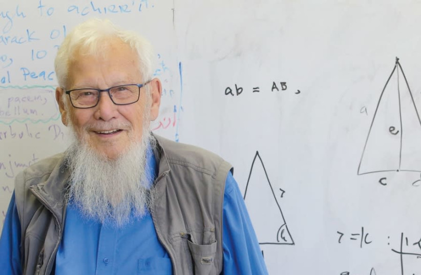 Prof. Yisrael Aumann stands in front of the board in his office (photo credit: MARC ISRAEL SELLEM)