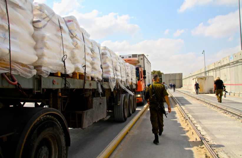 Humanitarian goods are transfered via the Kerem HaShalom crossing from Israel into Gaza. (photo credit: TOVAH LAZAROFF)