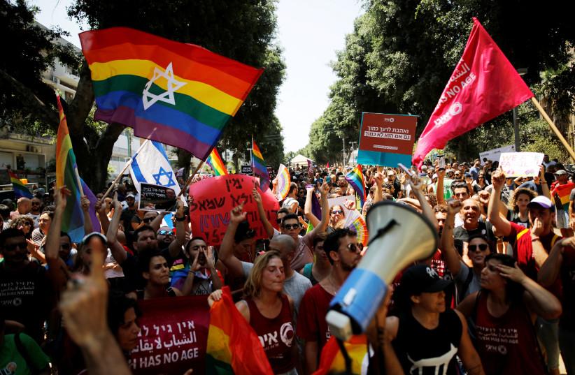 Protestors shout slogans during a LGBT community members protest against discriminatory surrogate bill in Tel Aviv, Israel July 22, 2018 (photo credit: CORINNA KERN/REUTERS)