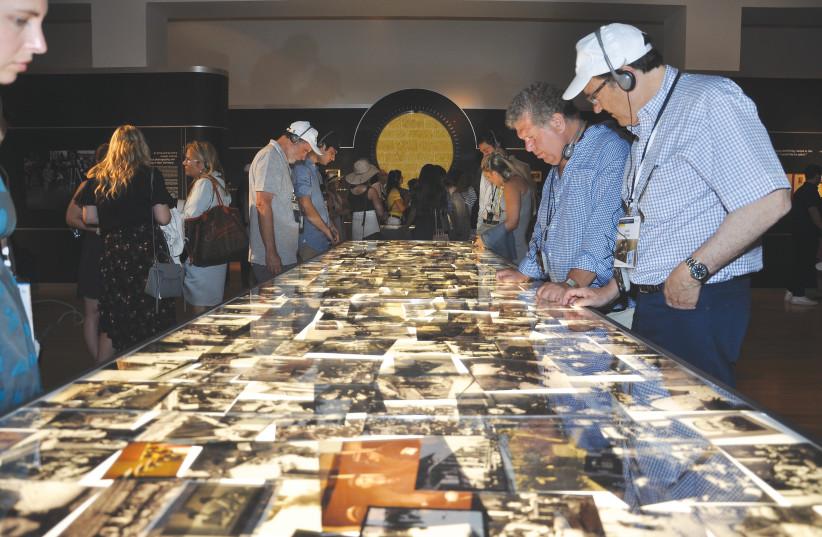 PARTICIPANTS IN the Generation to Generation Mission tour the Flashes of Memory exhibition at Yad Vashem (photo credit: COURTESY YAD VASHEM)