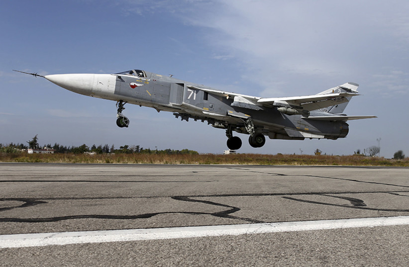 A Sukhoi Su-24 fighter jet takes off from the Hmeymim air base near Latakia, Syria, in this handout photograph released by Russia's Defence Ministry on October 22, 2015.  (photo credit: MINISTRY OF DEFENCE/HANDOUT VIA REUTERS)