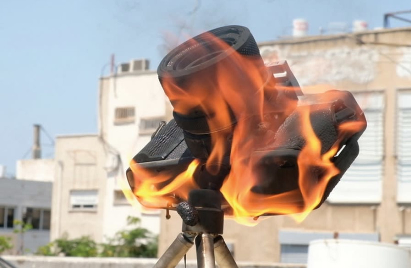BEZALEL BEN CHAIM's 'Burning Camera' (photo credit: Courtesy)