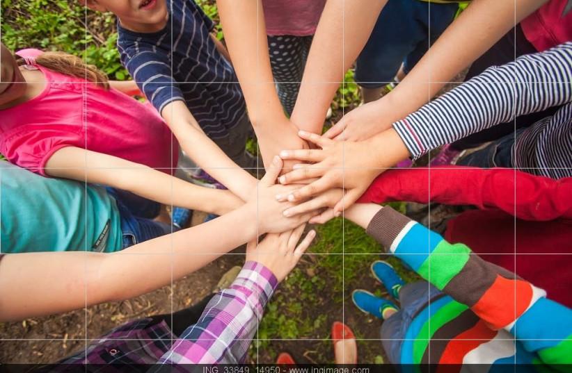 Children join hands in nature [illustrative] (photo credit: INGIMAGE)