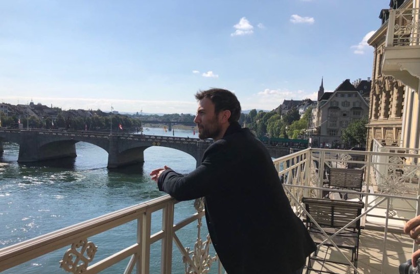 Paralymic tennis player Noam Gershony poses on Theodor Herzl's balcony, recreating the iconic photograph (photo credit: IFAT SHOMRONY & EYAL BEN ZEEV COMMUNICATIONS)