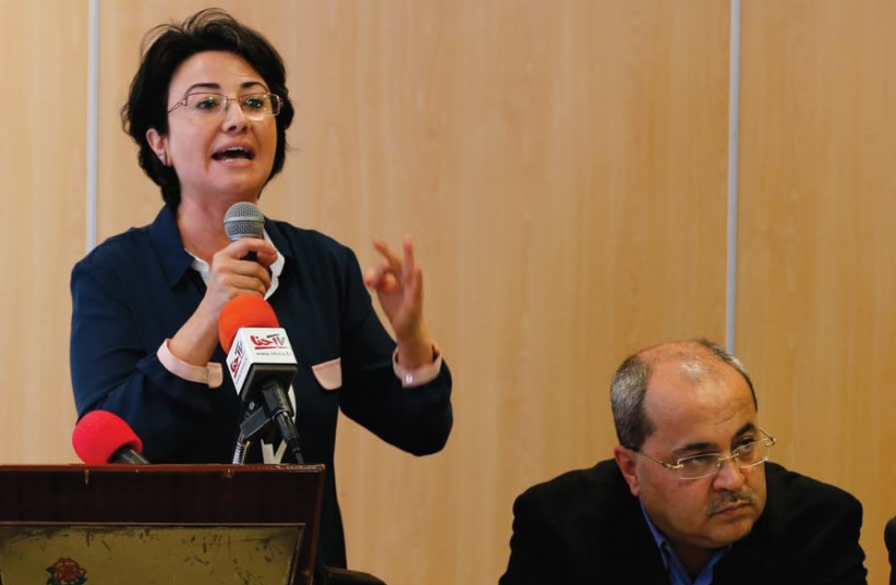 MK Haneen Zoabi [L] speaks at a news conference announcing the Joint List political slate of all the Arab parties with Ahmed Tibi [R], in Nazareth in 2015 (photo credit: AMMAR AWAD/REUTERS)
