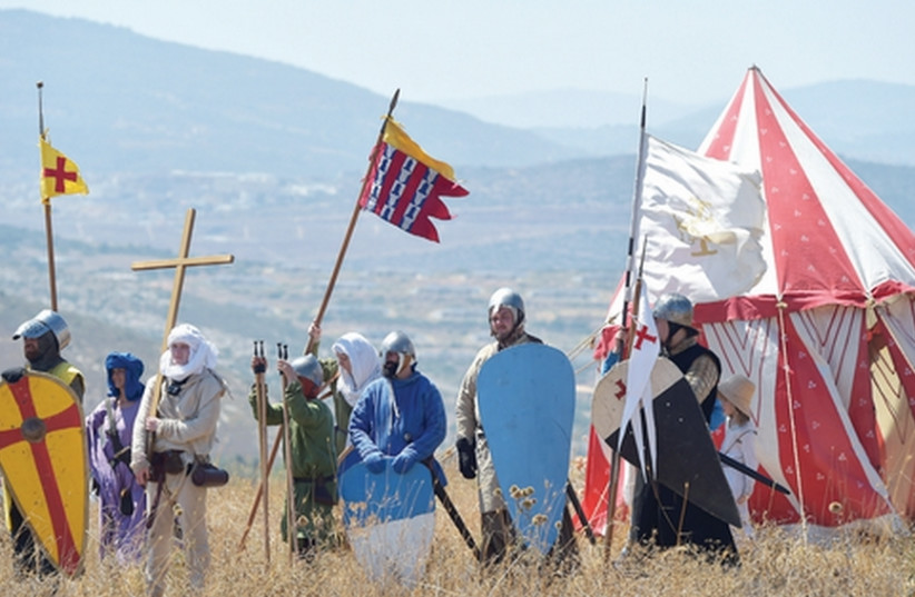 A GROUP of about 20 men take part in a three-day reenactment of the Battle of Hattin, which climaxed with the beheading of Raynald de Châtillon at Horns of Hattin, overlooking the Kinneret. (photo credit: MEIR VAKNIN/FLASH90)