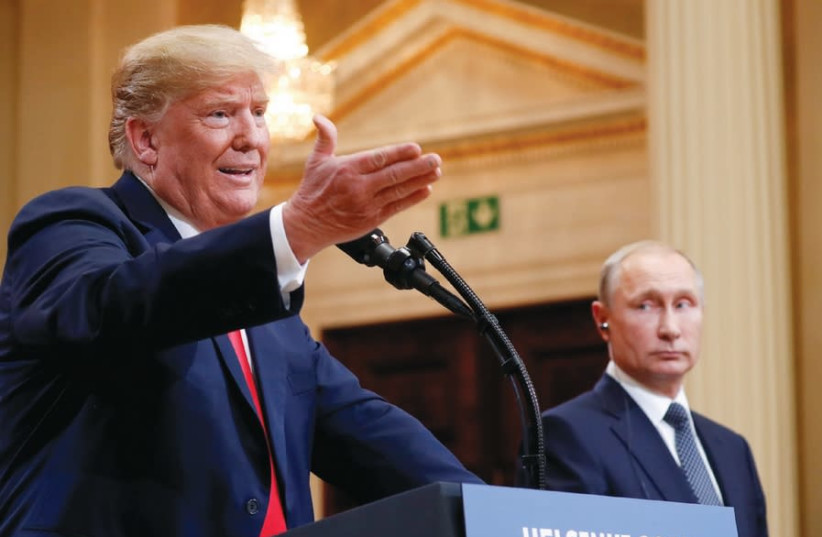 US PRESIDENT Donald Trump gestures during a joint news conference with Russia's President Vladimir Putin after their meeting in Helsinki, Finland, July 2018 (photo credit: KEVIN LAMARQUE/REUTERS)