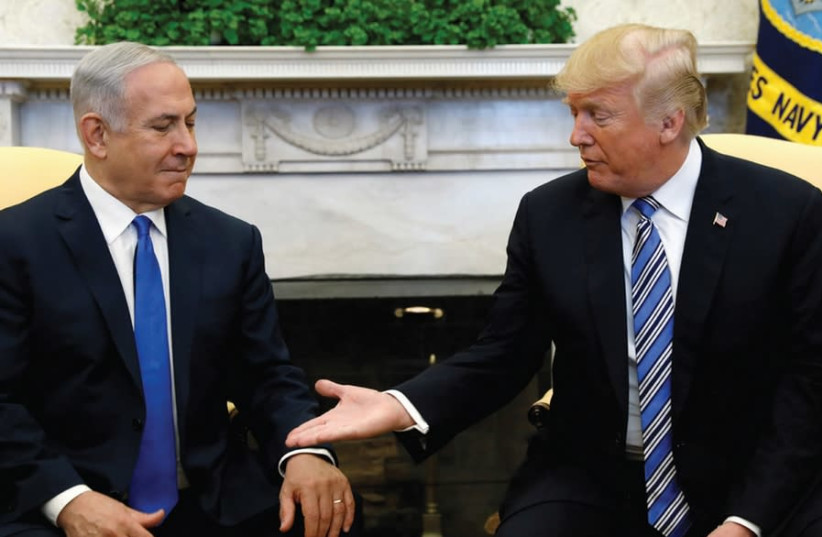 PRIME MINISTER Benjamin Netanyahu meets with US president Donald Trump in the Oval Office of the White House in Washington, 2018 (photo credit: KEVIN LAMARQUE/REUTERS)