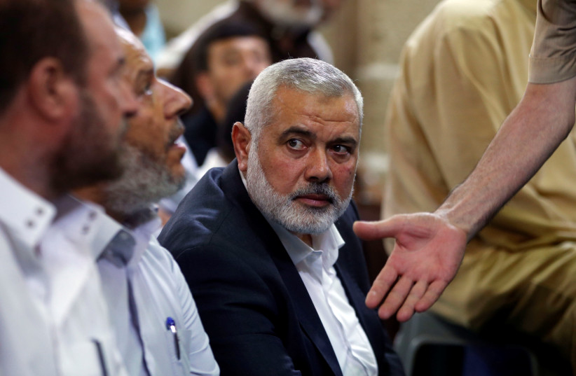 Hamas Chief Ismail Haniyeh looks on as he attends the funeral of Palestinian Hamas militants who were killed in Israeli tank fire, at a mosque in Gaza City July 26, 2018 (photo credit: MOHAMMED SALEM/REUTERS)