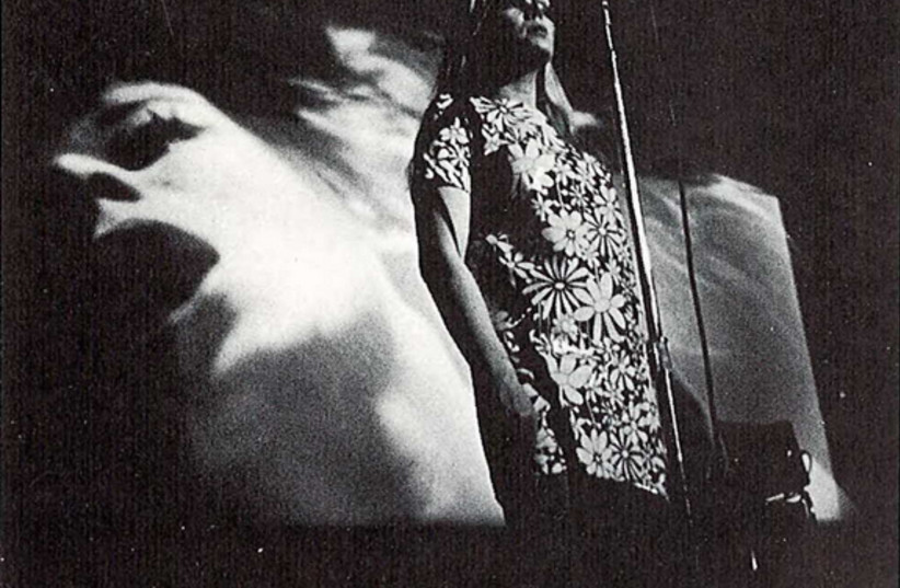 Nico performing with Andy Warhol's Exploding Plastic Inevitable in Ann Arbor, Michigan, 1966 (photo credit: WIKIMEDIA)