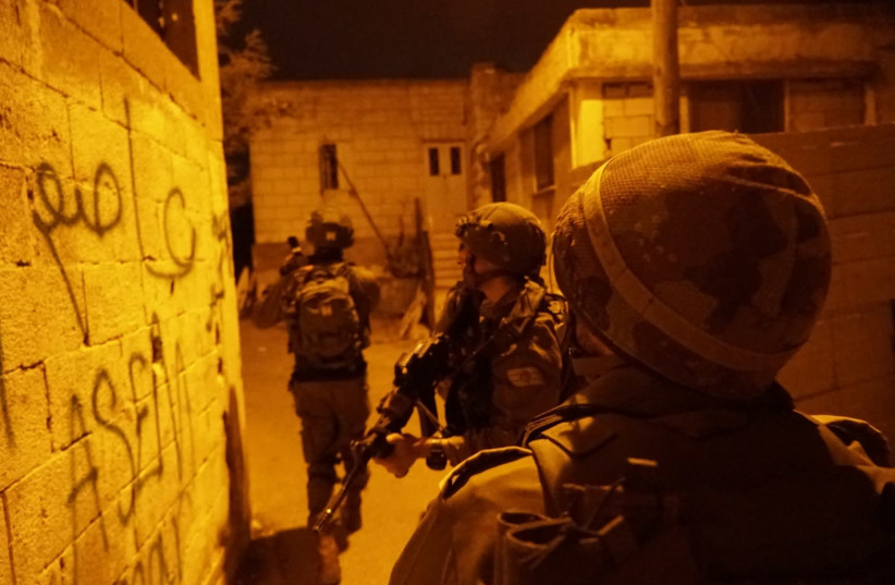 IDF soldiers seen during overnight activity following Thursday's stabbing attack, July 28, 2018 (photo credit: IDF SPOKESPERSON'S UNIT)
