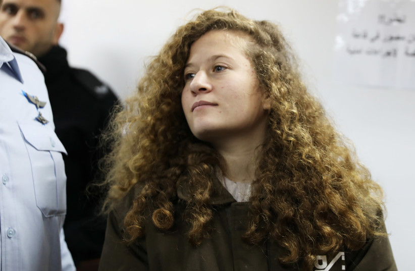 Palestinian teen Ahed Tamimi enters a military courtroom at Ofer Prison, near the West Bank city of Ramallah, January 15, 2018 (photo credit: AMMAR AWAD / REUTERS)