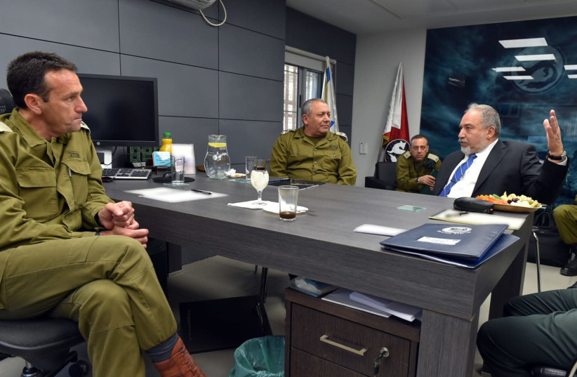 Defense Minister Avigdor Liberman (R) is briefed about the security situation near Gaza, July 29, 2018 (photo credit: ARIEL HERMONI / DEFENSE MINISTRY)